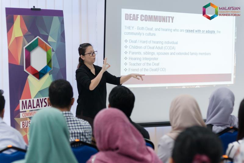 MyBIM sign language instructor Annie Ong describes aspects of the Deaf community. (Photo credit: MyCPBF)