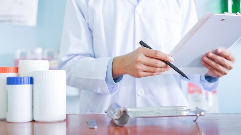 Pharmacist dispensing medicines